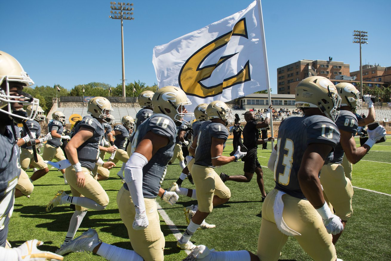 ESU Football team running onto the football field